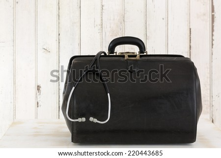 Home call, doctor's bag with stethoscope - stock photo