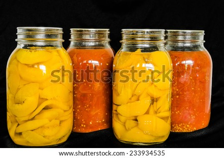 Home Canned Peaches and Tomatoes. - stock photo