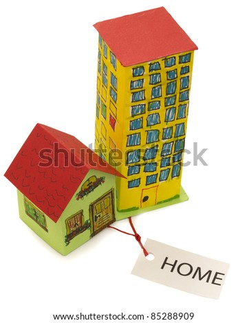 Home concept, little house or skyscraper as a home