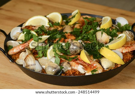 Home cooked chicken spanish paella with seafood toppings / Spanish paella / Easy and simple to prepare, favorite choice for many household  - stock photo