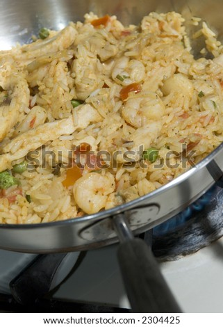 home cooked paella with chicken and seafood