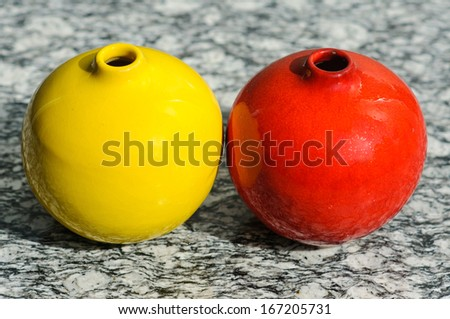 Home decoration, yellow and red round vase - stock photo
