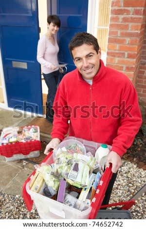 Home Delivery Grocery Driver Unloading Customer's Shopping - stock photo