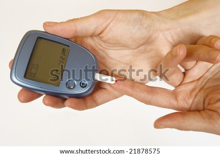 Home Diabetes self-test kit showing drop of blood being tested. - stock photo