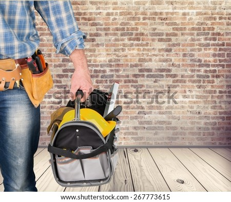 Home. Electrical mechanic with toolbox and white background - stock photo