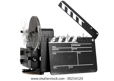 Home Entertainment System from the Past - a film slate and a 8mm Film Projector isolated on white - stock photo