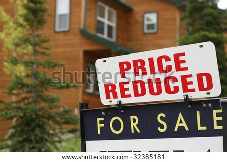 Home For Sale Price Reduced Sign - stock photo