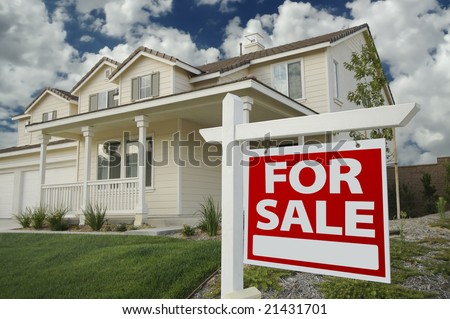 Home For Sale Sign in Front of Beautiful New Home - stock photo