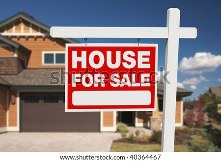 Home For Sale Sign in Front of New House - stock photo