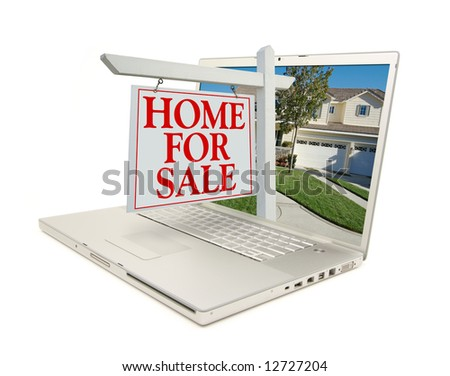 Home for Sale Sign & New Home on Laptop isolated on a white Background. - stock photo