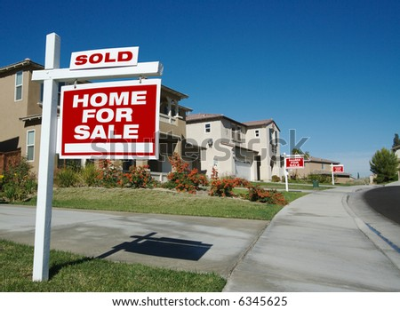 Home For Sale Signs & One Sold in Front of Beautiful New Homes - stock photo
