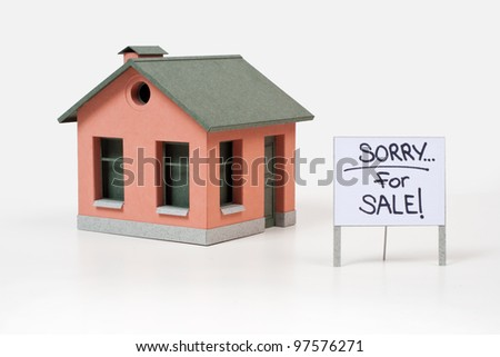 Home for sale. The composition which manually has been cut out from a colour paper - stock photo