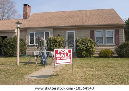 Home for sale with man working in background