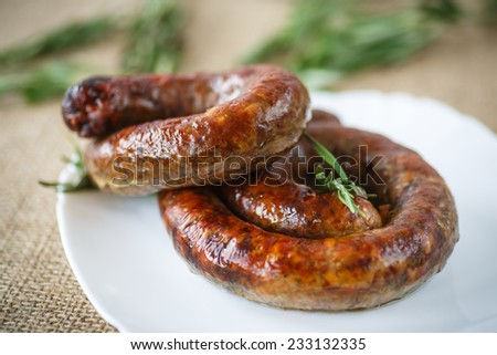 home fried sausage with rosemary on a plate - stock photo