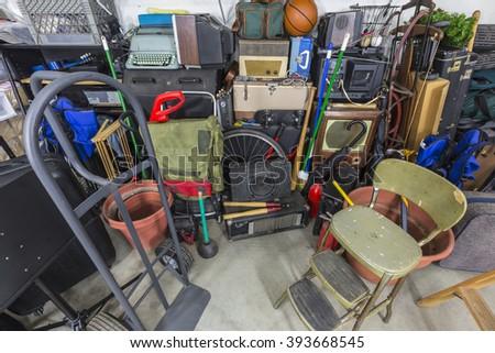 Home garage storage mess.   - stock photo