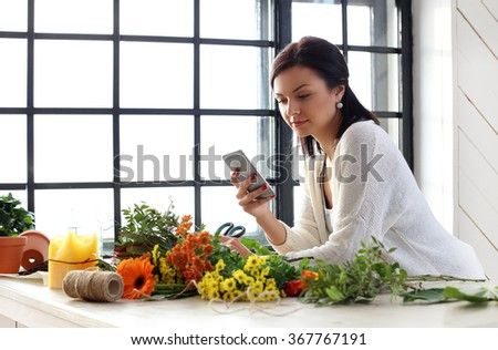 Home, gardening. Woman with flowers - stock photo