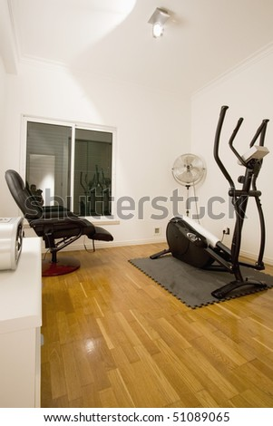 home gymnasium with television in mansion private residence - stock photo