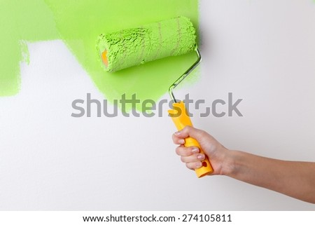 Home. Hand painting wall in green - stock photo