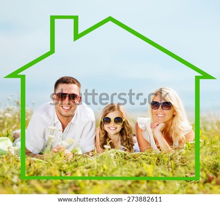 home, happiness and real estate concept - happy family in sunglasses lying on a grass with house shaped illustration - stock photo