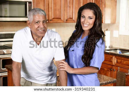 Home health care worker and an elderly man - stock photo