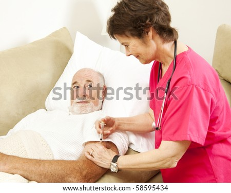 Home health nurse giving a shot to an elderly patient.