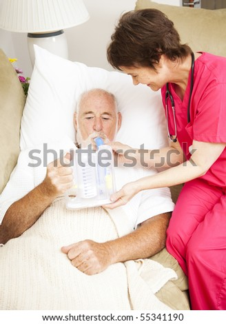Home health nurse uses spirometer to strengthen patient's lungs and prevent pneumonia. - stock photo