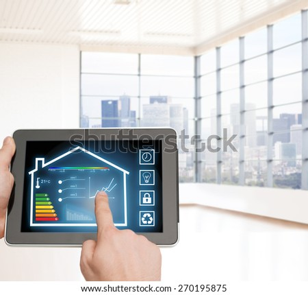 home, housing, people and technology concept - close up of man hands pointing finger to tablet pc computer and regulating room temperature over empty flat background - stock photo