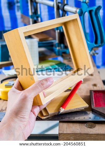 Home improvement / handyman working  with woodworking tools in workshop - stock photo