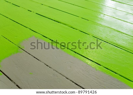 home improvement painting the floor with green paint - stock photo