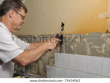 Home improvement - removing old tiles - stock photo