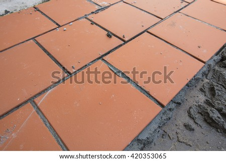 Home improvement, renovation construction trowel with cement mortar for tiles work, tile floor adhesive - stock photo