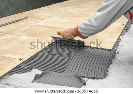 Delightful Home Improvement, Renovation   Construction Worker Tiler Is Tiling, Ceramic Tile  Floor Adhesive