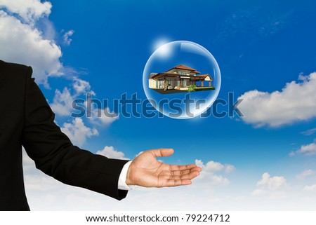 Home in bubble over business man hand against  blue sky - stock photo