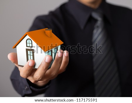 home in business man hand - stock photo