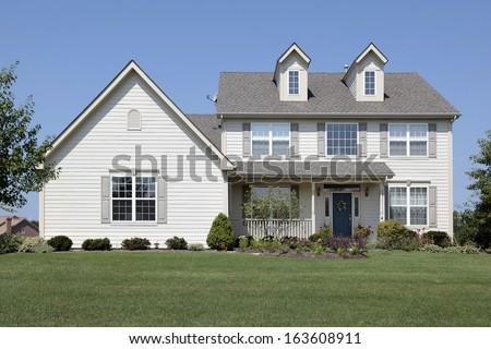 Home in suburbs with blue door - stock photo
