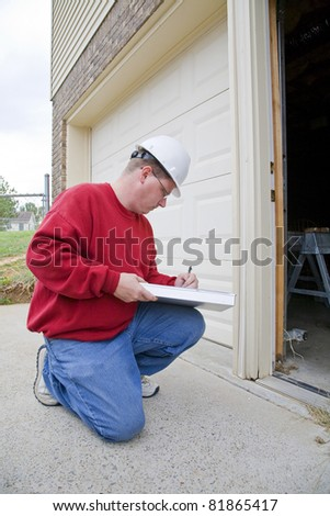 Home inspector looking for possible problems for a potential buyer, found rotted wood frame on exterior door frame - stock photo