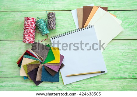 Home interior decoration and renovation planning concept. Open notebook on wooden background - stock photo