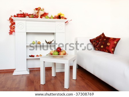 Home interior in white  with decorated sideboard for autumn and Thanksgiving - stock photo