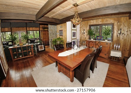Home Interior shot of a dining room in a cedar log chalet home. - stock photo