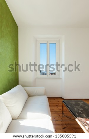 home interior, view of the living room, white divan, detail - stock photo