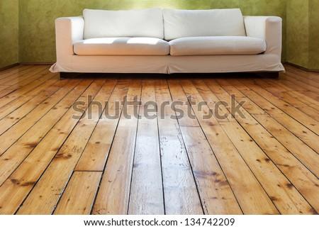 home interior, view parquet and white sofa - stock photo
