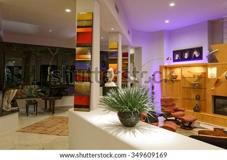Home interior with artwork, grand piano, and accent illumination. - stock photo