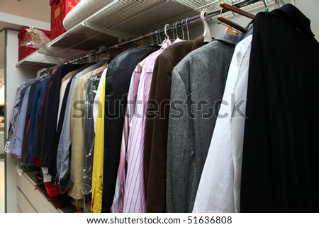 Home interior with male clothing hanging on - stock photo