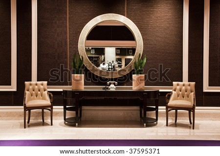 Home interior with mirror and sofa chairs [ Living Room Showroom] - stock photo