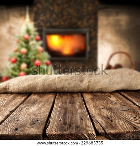 home interior with sack fireplace table and tree  - stock photo