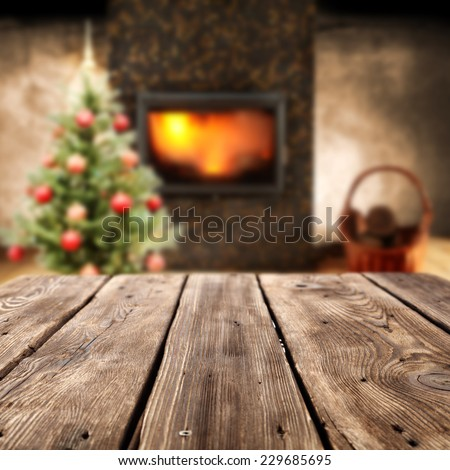 home interior with worn table of free space and fireplace  - stock photo