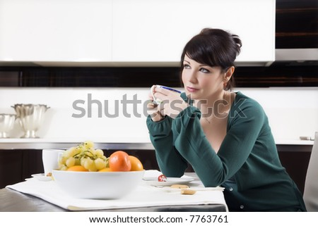 home life: woman relaxing and drinking a cup of tea - stock photo