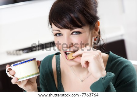 home life: woman relaxing and drinking a cup of tea