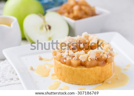 Home made apple crumble with cake in clear container - stock photo