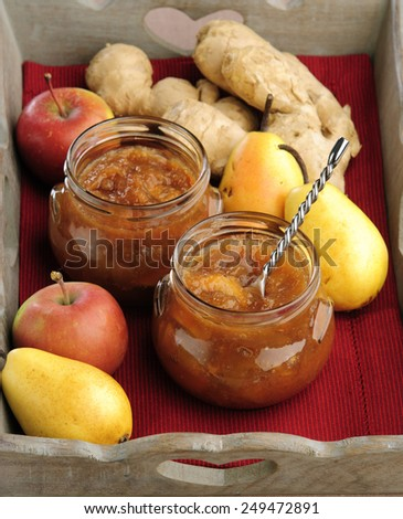 Home made apple pear ginger in a glass jar on a wooden tray - stock ...